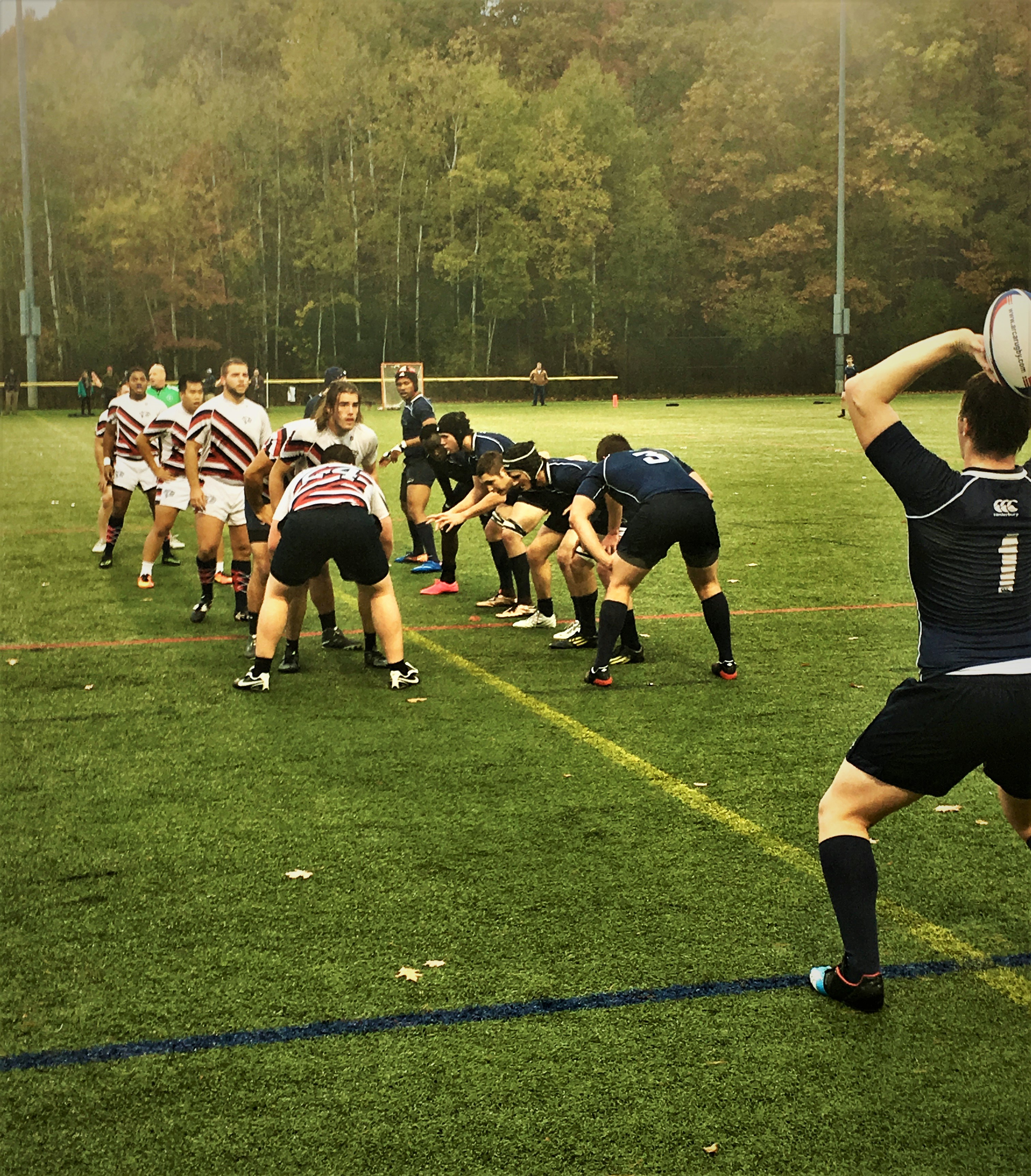 UNH mens rugby sets up for a play