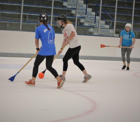 students playing broomball