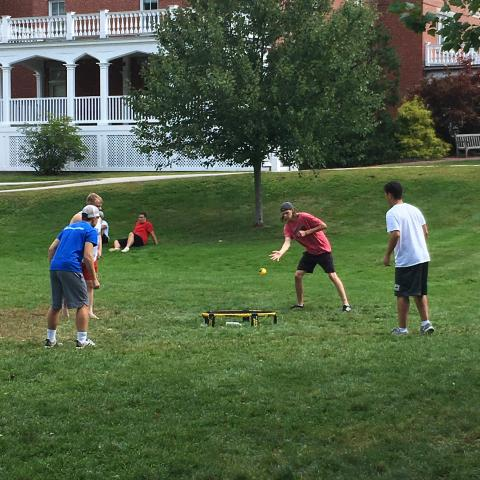 students outside playing spike ball